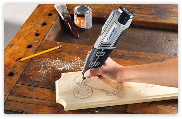 Person using Dremel to engrave